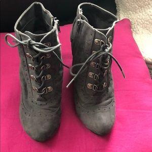 Gray zip up/lace wedge heel booties. Size 6.5 U.S.